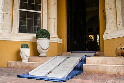 a ramp with cloth protection underneath to protect the stairs